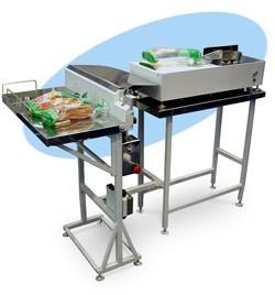 Клипсатор, машина для раскрытия пакетов и стол